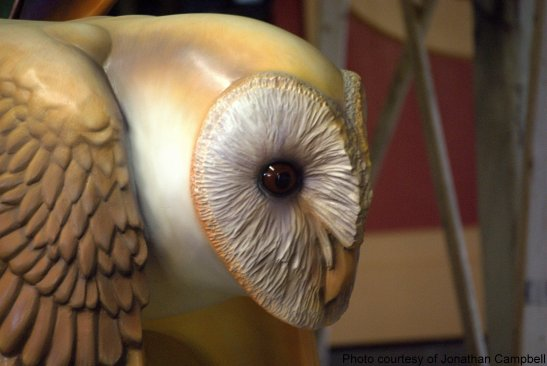William Rogers finishes carousel owl with hand painted detail