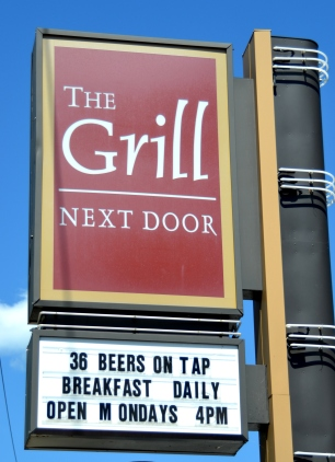 The Grill Next Door sign
