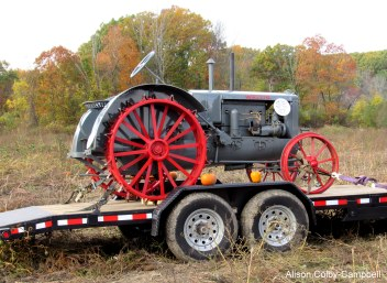this antique was for sale. note steel wheels and the hint of similar design to a steam engine